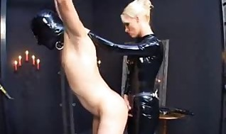 Domme, he's tied, belt cock