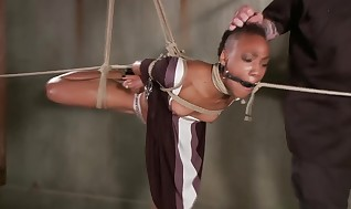 Hog-tied black slave ruled by her sir