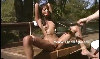 Ebony ultra-cutie used like a gimp outdoor in cruel Bondage & Discipline hookup roped on a bench and tantalized