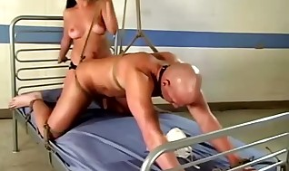 Nurse Penny Flame pegging clean-shaved patient whos is trussed to sofa