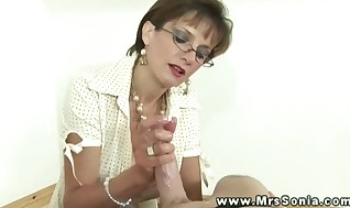 Huge breasted mature keeps wanking dick