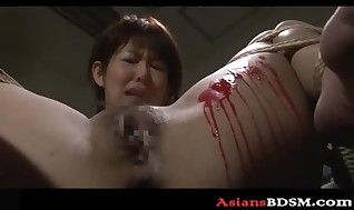 Nasty Asian hotty decorated in paraffin wax