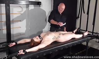Restrain bondage rack penalties and injection needle titty torment of sobbing slavegirl Isabel Deal in redhead Bondage & Discipline and piercing tantalizes in the dungeon space